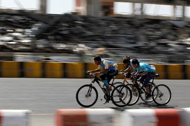 Cyclists take part in a race marking the National Cycling Day in Sanaa, Yemen May 10, 2018. REUTERS/Mohamed al-Sayaghi