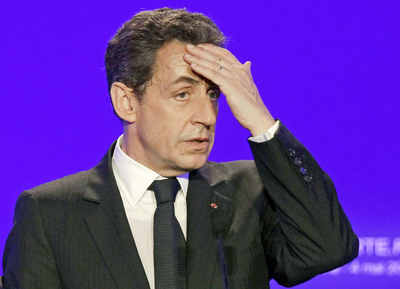 FILE - This Friday, May 4, 2012 file photo shows France's then President and conservative candidate for re-election in 2012, Nicolas Sarkozy as he delivers a speech in Sables d'Ollonne, western France. Sarkozy went before a judge on Thursday, Nov.22, 2012 to respond to suspicions he illegally accepted donations from France's richest woman to fund his 2007 election campaign. The judge in Bordeaux could decide whether the 57-year-old conservative, a polarizing figure who often faced criticism for cozy ties to the rich, will be charged with taking advantage of the 90-year-old L'Oreal heiress, Liliane Bettencourt. Sarkozy has consistently denied all allegations.(AP Photo/Michel Euler, File)