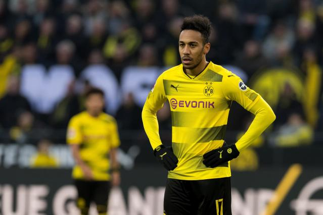 "<a class=""link rapid-noclick-resp"" href=""/soccer/players/pierre-emerick-aubameyang/"" data-ylk=""slk:Pierre-Emerick Aubameyang"">Pierre-Emerick Aubameyang</a> played for <a class=""link rapid-noclick-resp"" href=""/soccer/teams/borussia-dortmund/"" data-ylk=""slk:Borussia Dortmund"">Borussia Dortmund</a> this weekend, it appears to be off to <a class=""link rapid-noclick-resp"" href=""/soccer/teams/arsenal/"" data-ylk=""slk:Arsenal"">Arsenal</a>. (Getty)"
