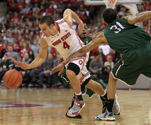 Ohio State's Aaron Craft, left, breaks the press between Chicago State's Jamere Dismukes, center, and Jeremy Robinson during the second half of an NCAA college basketball game on Saturday, Dec. 29, 2012, in Columbus, Ohio. Ohio State defeated Chicago State 87-44. (AP Photo/Jay LaPrete)