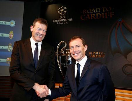 Andreas Jung (L), Executive Board Member of Bayern Munich, shakes hand with Real Madrid's director Emilio Butragueno after the draw of the UEFA Champions League quarterfinals in Nyon, Switzerland March 17, 2017. REUTERS/Denis Balibouse