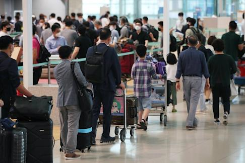 South Korean travellers in the departure lobby of Terminal 2 at the Incheon airport in South Korea on 23 July 2020 for their departure to the Chinese provincial city of Guangzhou. Photo: EPA-EFE