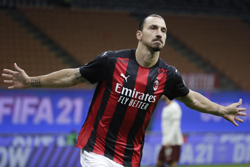 AC Milan's Zlatan Ibrahimovic celebrates after scoring his side's opening goal during the Serie A soccer match between AC Milan and Roma at the Milan San Siro Stadium, Italy, Monday, Oct. 26, 2020. (AP Photo/Luca Bruno)