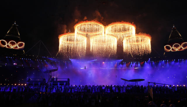 The Olympic rings are seen during a pyrotechnics display at the pre-show before the opening ceremony of the London 2012 Olympic Games at the Olympic Stadium July 27, 2012. REUTERS/Suzanne Plunkett (BRITAIN - Tags: SPORT OLYMPICS)