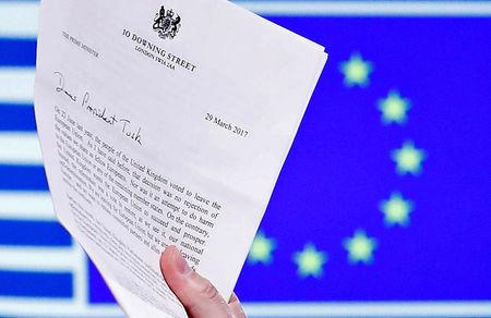 EU Council President Donald Tusk holds British Prime Minister Theresa May's Brexit letter in Brussels
