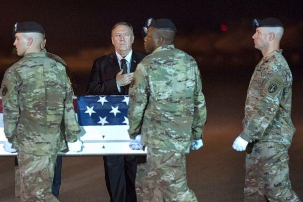 PHOTO: An Army carry team moves a transfer case containing the remains of Sgt. 1st Class Elis Barreto Ortiz, 34, from Morovis, Puerto Rico, past Secretary of State Mike Pompeo, Sept. 7, 2019. (Cliff Owen/AP)