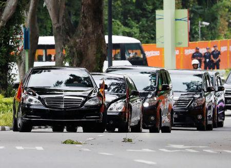 The motorcade of North Korea's leader Kim Jong Un arrives at the Capella hotel, the venue of the summit between North Korea and the U.S., on Sentosa island in Singapore June 12, 2018. REUTERS/Kim Kyung-hoon