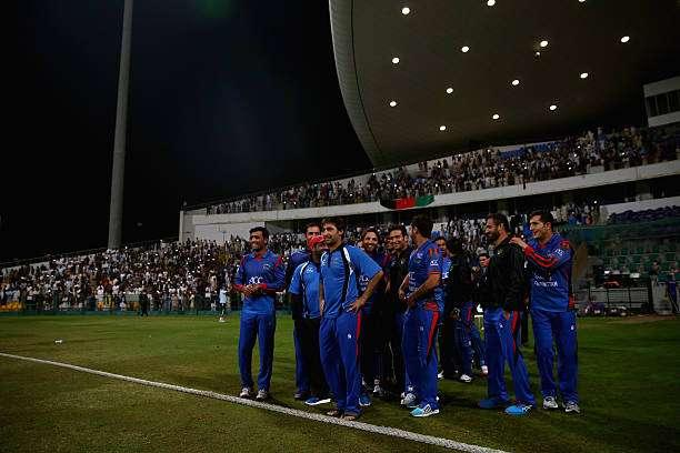 ABU DHABI, UNITED ARAB EMIRATES - JANUARY 16: Players of Afghanistan celebrate after winning the Desert T20 Challenge match between Afghanistan and UAE at Sheikh Zayed Stadium on January 16, 2017 in Abu Dhabi, United Arab Emirates. (Photo by Francois Nel/Getty Images)