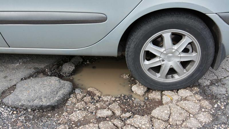 Big pothole caused by freezing temperatures and rain