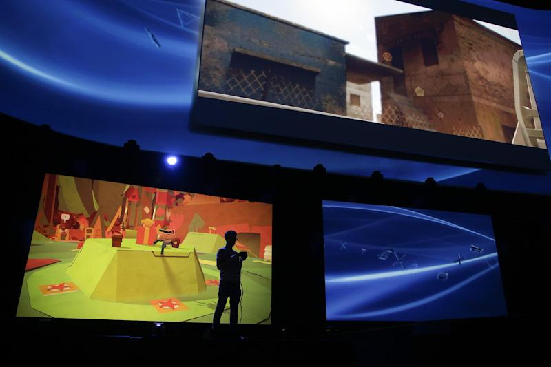 A gamer plays a video game at the Sony PlayStation E3 media briefing in Los Angeles, Monday, June 10, 2013. Sony is giving gamers their first look at the PlayStation 4 and it's a rectangular black box, just like all the previous PlayStations. (AP Photo/Jae C. Hong)
