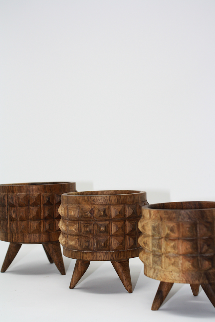 """Made in the Yucatan region of Mexico, these handcrafted wooden pots are recommended for cacti and come packed with personality. $65, Vía Raíz. <a href=""""https://viaraiz.com/collections/decor/products/estoperoles-plant-pots-set-of-3?variant=1376335003675"""" rel=""""nofollow noopener"""" target=""""_blank"""" data-ylk=""""slk:Get it now!"""" class=""""link rapid-noclick-resp"""">Get it now!</a>"""