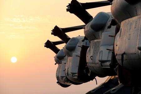 Wings of MV-22 Osprey aircrafts are seen during sunset on the flight deck of USS Boxer (LHD-4) in the Arabian Sea off Oman