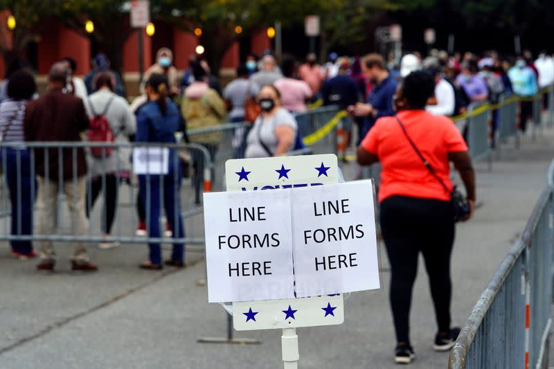 FILE PHOTO: Voters line up to cast their election ballot in Marietta