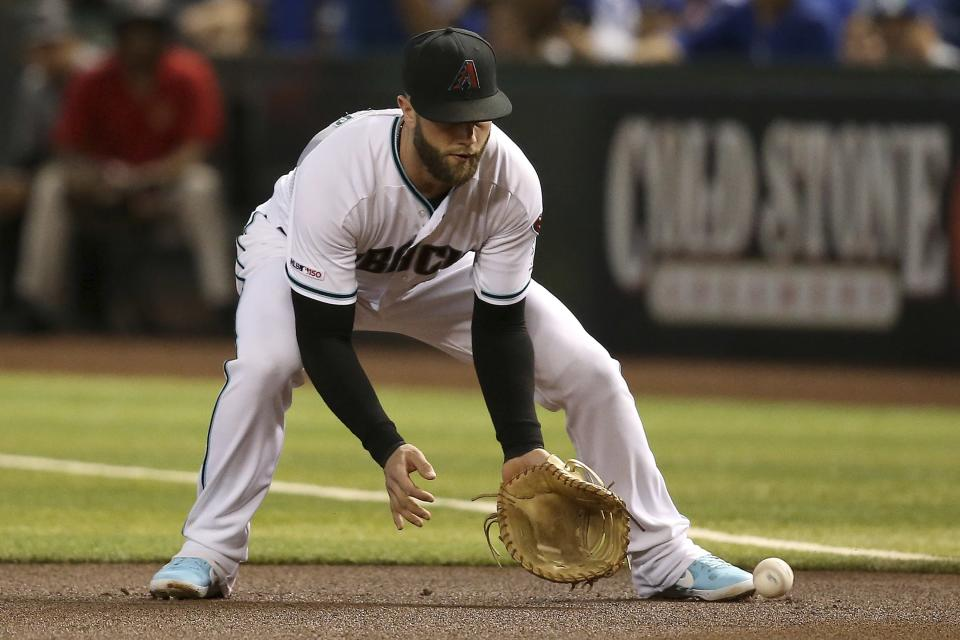Arizona Diamondbacks first baseman Christian Walker fields a grounder hit by Los Angeles Dodgers' Matt Beaty, before running to first base for the out during the first inning of a baseball game Friday, Aug. 30, 2019, in Phoenix. (AP Photo/Ross D. Franklin)