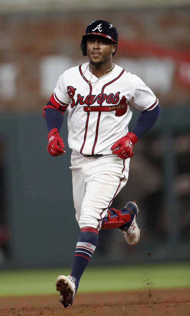 Atlanta Braves second baseman Ozzie Albies (1) rounds the bases after hitting a home run during the seventh inning of a baseball game against the Philadelphia Phillies on Friday, Sept. 21, 2018, in Atlanta. (AP Photo/John Bazemore)