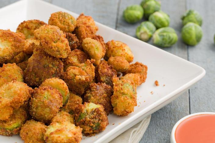 """<p>Even if you hate vegetables, you won't be able to stop eating these highly addictive (and totally disguised) pan-fried Brussels sprouts. Serve with buffalo sauce FTW.</p><p>Get the recipe from <a href=""""https://www.delish.com/holiday-recipes/thanksgiving/recipes/a44804/buffalo-brussels-sprouts/"""" rel=""""nofollow noopener"""" target=""""_blank"""" data-ylk=""""slk:Delish"""" class=""""link rapid-noclick-resp"""">Delish</a>.</p>"""