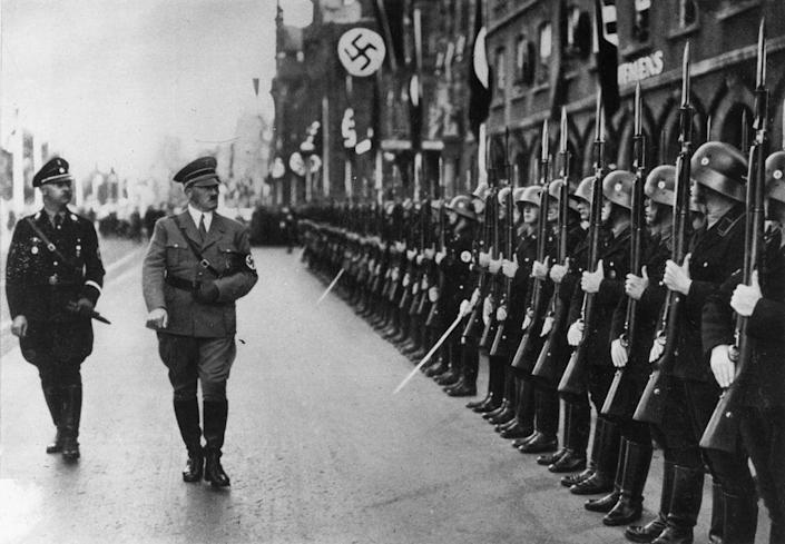 German dictator Adolf Hitler (1889 - 1945) and his chief of police Heinrich Himmler (1900 - 1945) inspecting the SS Guard (Getty Images)