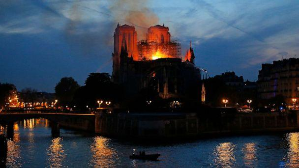 PHOTO: Firefighters tackle the blaze as flames rise from Notre Dame cathedral as it burns in Paris, April 15, 2019. (Michel Euler/AP)