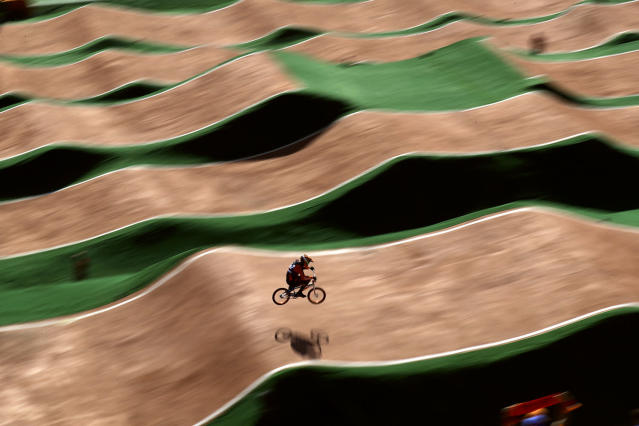 <p>In this photo taken with slow shutter speed, Jelle van Gorkom of the Netherlands competes in the men's seeding run at the Olympic BMX Center during the 2016 Summer Olympics in Rio de Janeiro, Brazil, Wednesday, Aug. 17, 2016. (AP Photo/Pavel Golovkin) </p>