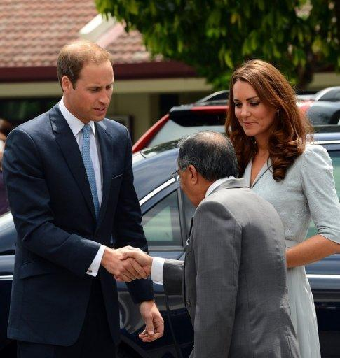 Britain's Prince William (left) shakes hand with Richard Robless, council member of Hospis Malaysia, upon arrival with his wife Catherine, the Duchess of Cambridge, in Kuala Lumpur on September 13. Britain's younger royals are touring the globe throughout 2012 as part of celebrations marking the 60-year reign of William's grandmother, Queen Elizabeth II