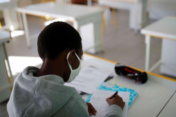 PHOTO: A student, wearing a protective face mask, works in a classroom in Nantes, France, May 20, 2020. (Stephane Mahe/Reuters)