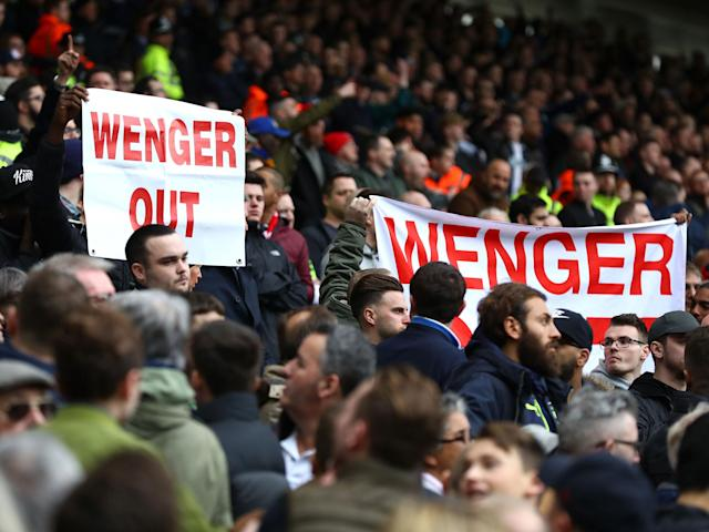 Arsenal fans call for Wenger to step down during the side's recent defeat by West Brom: Getty