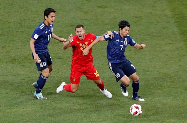 <p>Belgium's Eden Hazard in action with Japan's Makoto Hasebe and Gaku Shibasaki REUTERS/Murad Sezer </p>