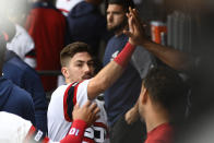 Chicago White Sox's Danny Mendick celebrates in the dugout after scoring during the first inning of a baseball game against the Los Angeles Angels, Sunday, Sept. 8, 2019, in Chicago. (AP Photo/Matt Marton)