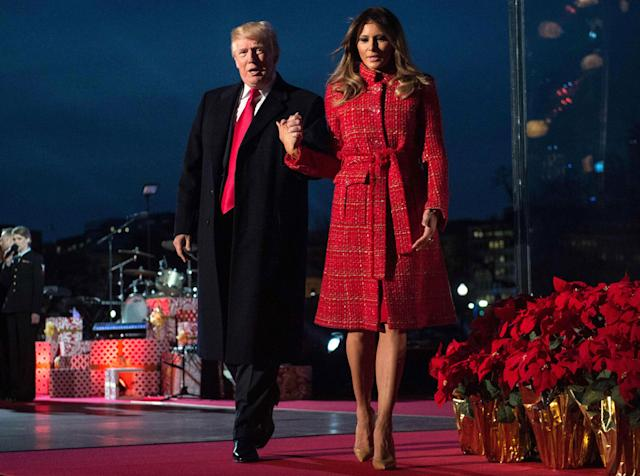 <p>President Donald Trump and First Lady Melania Trump walk off the stage during the 95th annual National Christmas Tree Lighting ceremony at the Ellipse in President's Park near the White House in Washington on Nov. 30, 2017. (Photo: Nicholas Kamm/AFP/Getty Images) </p>