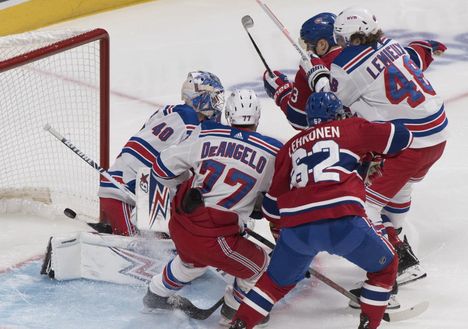 Montreal Canadiens' Max Domi (13) scores against New York Rangers goaltender Alexandar Georgiev as Rangers' Brendan Lemieux (48) and Tony DeAngelo (77) and Canadiens' Artturi Lehkonen look for a rebound during the first period of an NHL hockey game Saturday, Nov. 23, 2019, in Montreal. (Graham Hughes/The Canadian Press via AP)