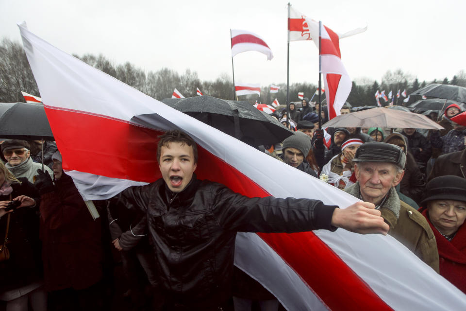 A prominent opponent of Belarus' authoritarian president Raman Pratasevich attends an opposition rally in Minsk, Belarus, Sunday, March 25, 2012. A prominent opponent of Belarus' authoritarian president has been arrested after the airliner in which he was traveling was diverted to the country after a bomb threat. The opposition and Western officials denounced the incident on Sunday, May 23, 2021 as a hijacking operation by the Belarus government. (AP Photo)