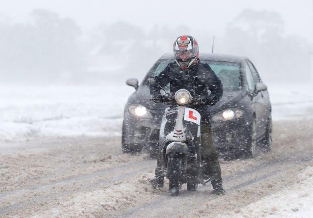 Vehicles make their way through snow near Kirby Cross in Essex