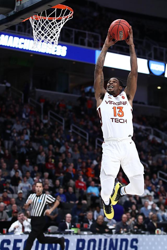 <p>Ahmed Hill #13 of the Virginia Tech Hokies dunks the ball against the Saint Louis Billikens during their game in the First Round of the NCAA Basketball Tournament at SAP Center on March 22, 2019 in San Jose, California. (Photo by Ezra Shaw/Getty Images) </p>
