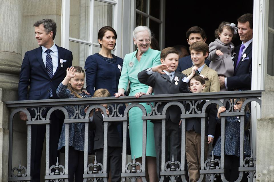 Queen Margrethe (c) of Denmark, with (L-R) Crown Prince Frederik, Princess Isabella, Crown Princess Mary, Prince Vincent (hidden behind bars), Prince Christian, Prince Nikolai (blue jacket), Prince Felix (brown jacket), Prince Henrik (dark blue jacket), Princess Athena, Prince Joachim and Princess Josephine in 2015. (Niels Ahlmann Olesen/AFP via Getty Images)