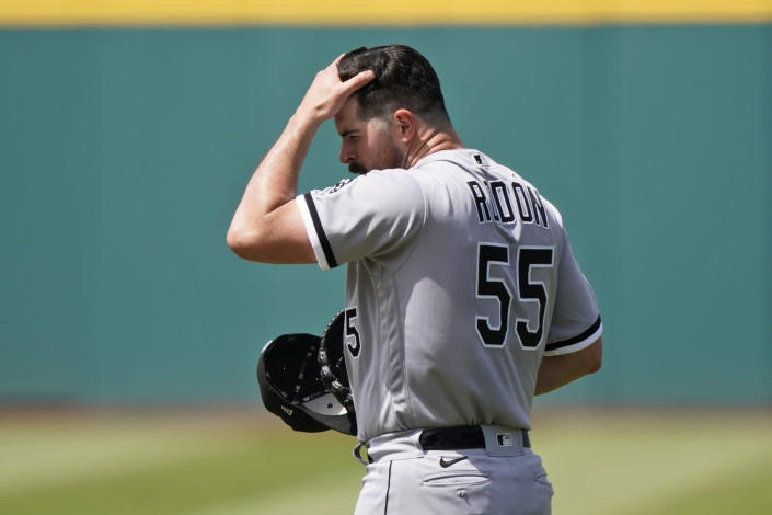 Chicago White Sox starting pitcher Carlos Rodon reacts after giving up a solo home run to Cleveland Indians' Amed Rosario in the first inning of the first baseball game of a doubleheader, Monday, May 31, 2021, in Cleveland. (AP Photo/Tony Dejak)