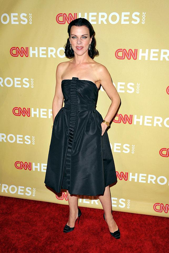 """""""Entourage's"""" Debi Mazar looked better than ever in a strapless LBD, gold cuff, and Christian Louboutin pumps. John Shearer/<a href=""""http://www.wireimage.com"""" target=""""new"""">WireImage.com</a> - November 21, 2009"""