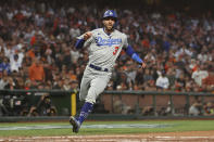 Los Angeles Dodgers' Chris Taylor runs home to score against the San Francisco Giants during the second inning of Game 2 of a baseball National League Division Series Saturday, Oct. 9, 2021, in San Francisco. (AP Photo/John Hefti)