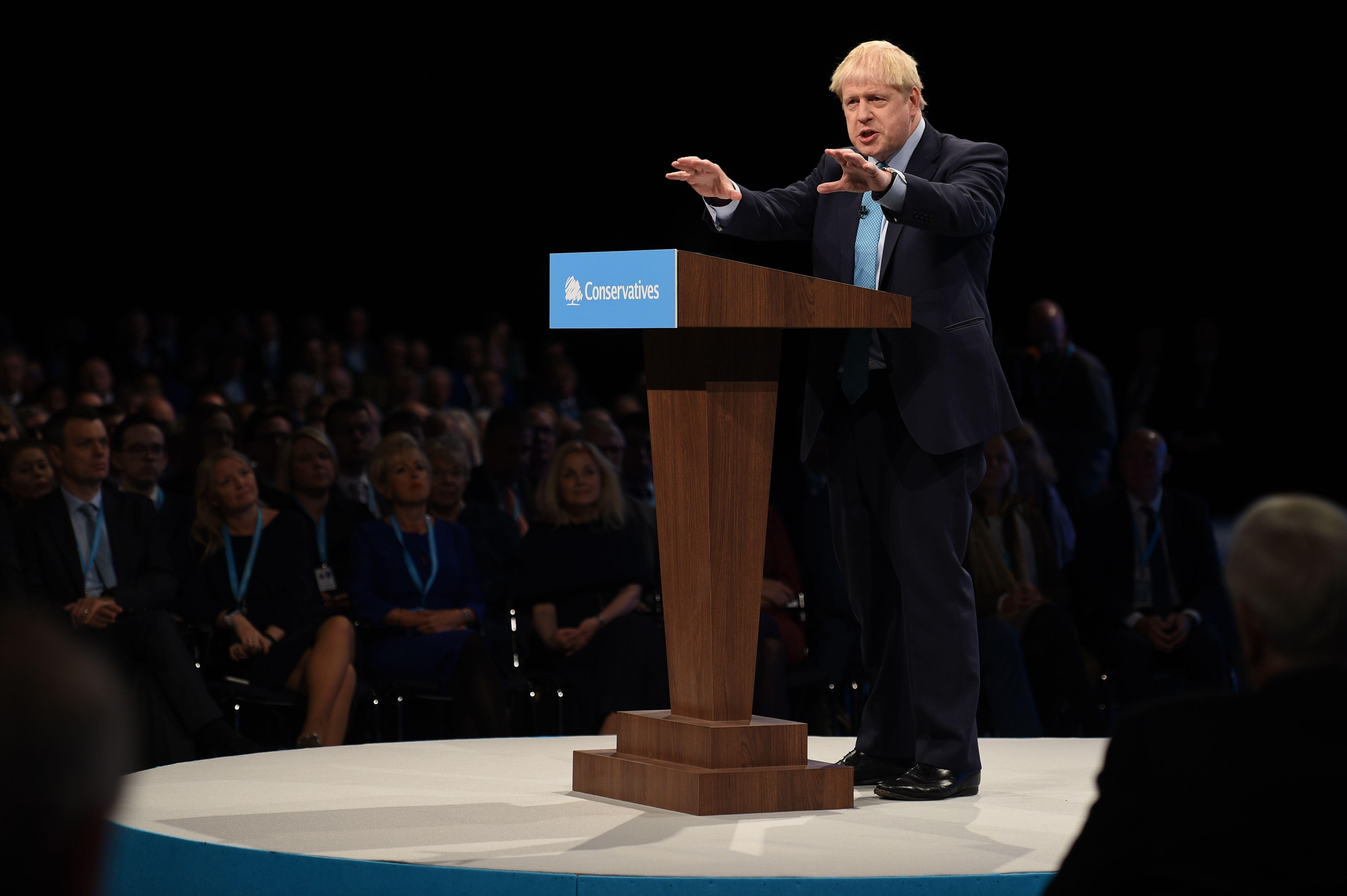 "Britain's Prime Minister Boris Johnson delivers his keynote speech to delegates on the final day of the annual Conservative Party conference at the Manchester Central convention complex, in Manchester, north-west England on October 2, 2019. - Prime Minister Boris Johnson was set to unveil his plan for a new Brexit deal at his Conservative party conference Wednesday, warning the EU it is that or Britain leaves with no agreement this month. Downing Street said Johnson would give details of a ""fair and reasonable compromise"" in his closing address to the gathering in Manchester, and would table the plans in Brussels the same day. (Photo by Oli SCARFF / AFP) (Photo by OLI SCARFF/AFP via Getty Images)"