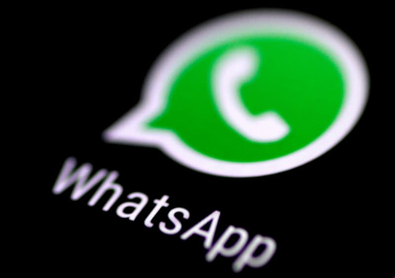 FILE PHOTO: FILE PHOTO: The WhatsApp messaging application is seen on a phone screen