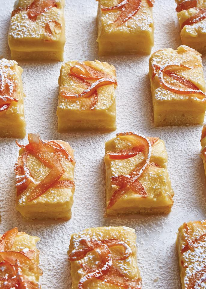 """Joy to the world: a citrus bar just as beautiful as it is zingy. The twice-cooked curd method was inspired by authors Rose Levy Beranbaum and Melissa Clark and ensures that these bars are extra sturdy and have a smooth, shiny surface. They hold their shape well even when sliced. <a href=""""https://www.bonappetit.com/recipe/grapefruit-bars-with-candied-zest?mbid=synd_yahoo_rss"""">See recipe.</a>"""
