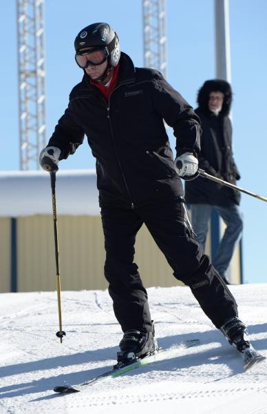 Russian President Vladimir Putin skies at the mountain resort of Krasnaya Polyana near the Black Sea resort of Sochi, southern Russia, Friday, Jan. 3, 2014. (AP Photo/RIA-Novosti, Alexei Nikolsky, Presidential Press Service)