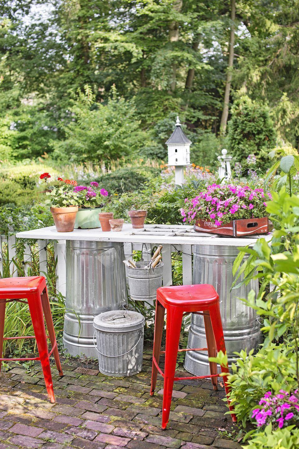 <p>Take upcycling to the next level: For a budget-friendly work bench, attach an old door or piece of wood to two waist-height metal pails or garbage cans. Place it near your garden, so you can keep your eye on your bounty as you work your magic. </p>