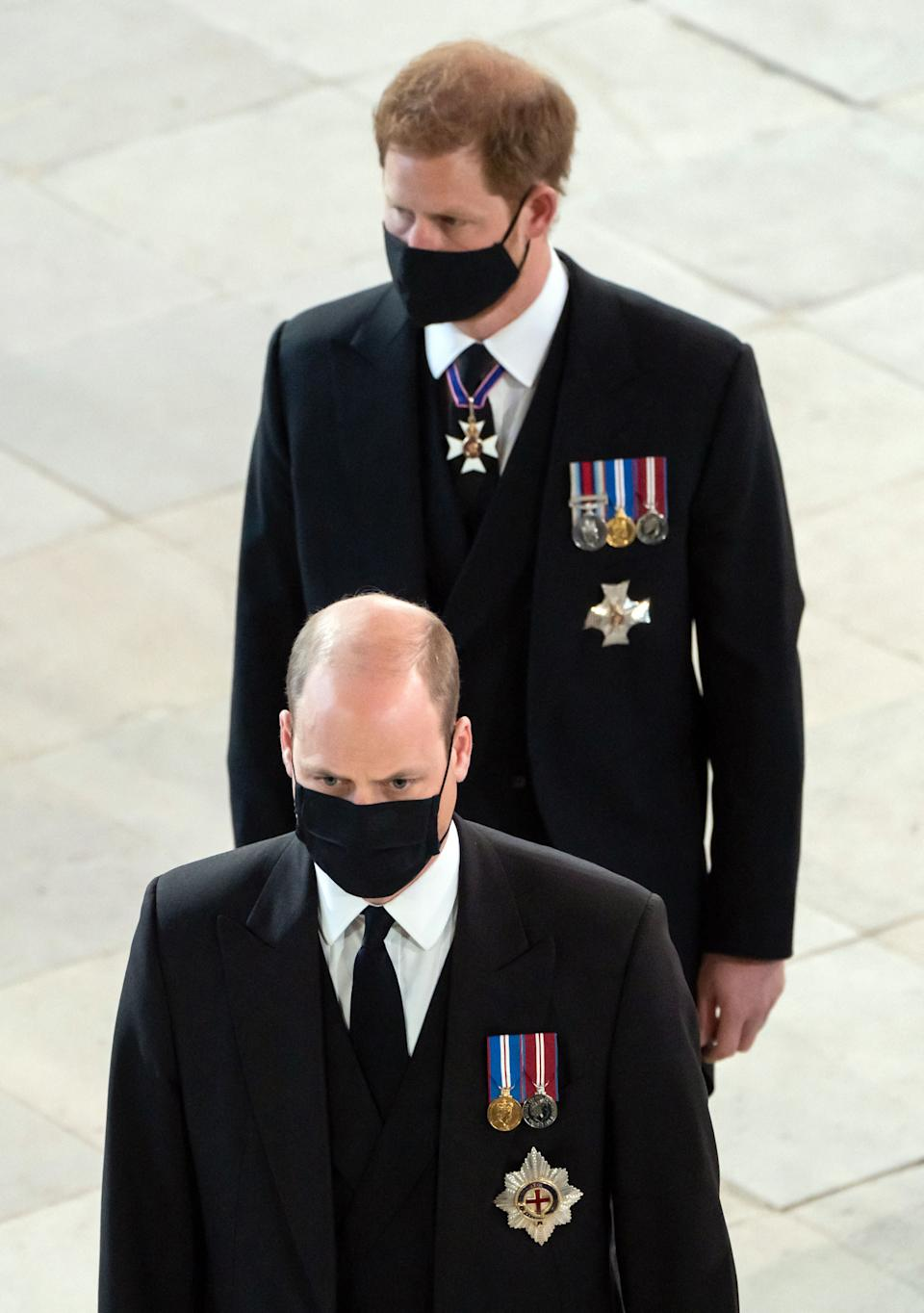 Britain's Prince William, Duke of Cambridge, (L) and Britain's Prince Harry, Duke of Sussex, arrive for the funeral service of