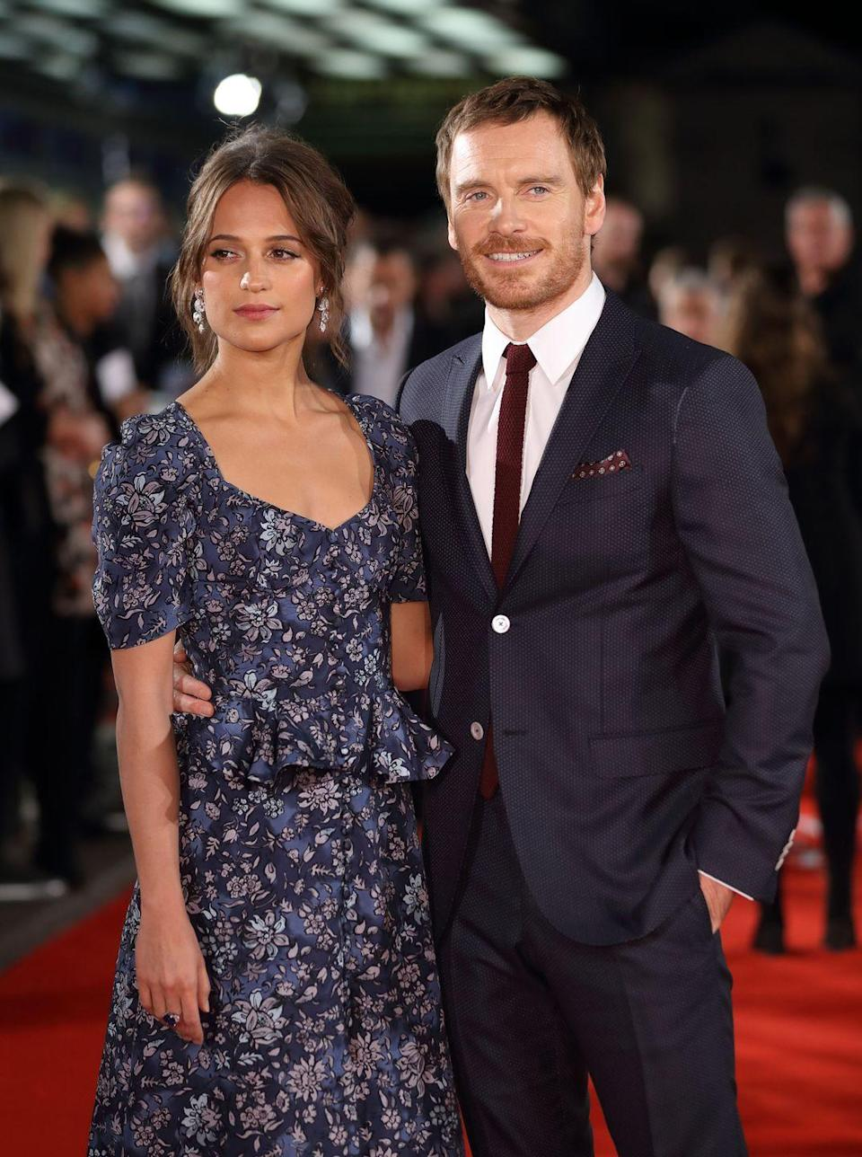 "<p>Alicia Vikander, 31, and husband Michael Fassbender, 43, started dating back in 2014 after meeting on the set of <em>The Light Between Oceans</em>. The lovebirds kept it low-key for the cameras at the beginning of their relationship, but were outed as a newlyweds after they returned from their <a href=""https://www.harpersbazaar.com/celebrity/latest/a13031336/alicia-vikander-michael-fassbender-married/"" rel=""nofollow noopener"" target=""_blank"" data-ylk=""slk:incognito wedding in Ibiza"" class=""link rapid-noclick-resp"">incognito wedding in Ibiza</a> in 2017.</p>"
