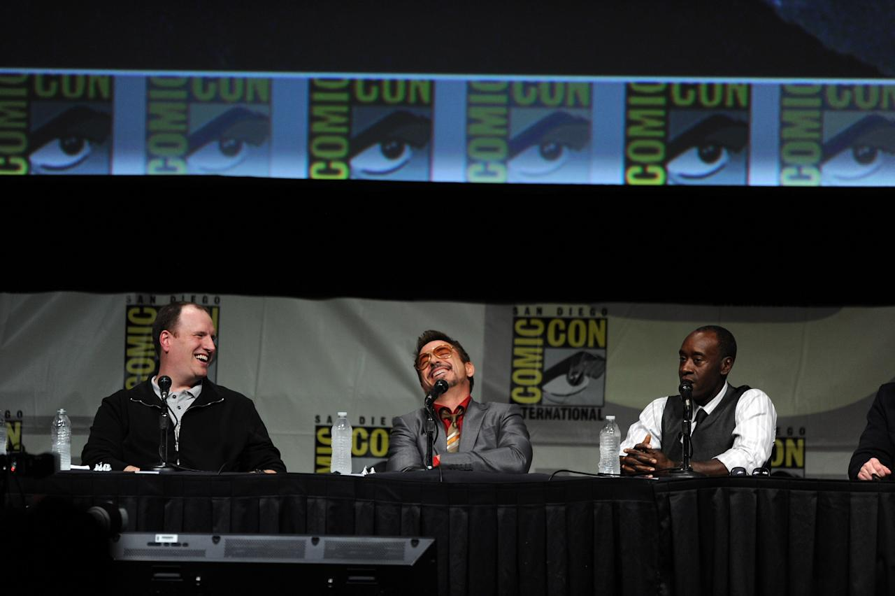 "SAN DIEGO, CA - JULY 14:  (L-R) Producer Kevin Feige, actors Robert Downey Jr., and Don Cheadle speak at Marvel Studios ""Iron Man 3"" panel during Comic-Con International 2012 at San Diego Convention Center on July 14, 2012 in San Diego, California.  (Photo by Kevin Winter/Getty Images)"