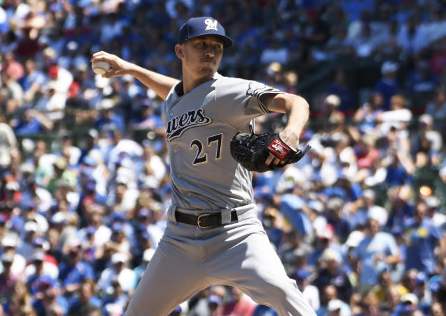 Milwaukee Brewers starting pitcher Zach Davies (27) throws the ball against the Chicago Cubs during the first inning of a baseball game, Friday, Aug. 2, 2019, in Chicago. (AP Photo/David Banks)