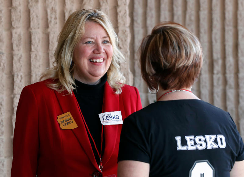 FILE - In this Jan. 27, 2018, file photo, former Arizona state Sen. Debbie Lesko speaks with a constituent during the meeting of the state committee of the Arizona Republican Party in Phoenix. Lesko is running against Hiral Tipirneni in a special election, Tuesday, April 24, to fill the U.S. House seat vacated by Republican Rep. Trent Franks. (AP Photo/Matt York, File)