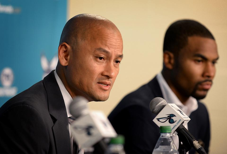 Charlotte Hornets general manager Rich Cho, left, answers a reporter's question during a news conference introducing guard Ramon Sessions, right, and center Roy Hibbert on Thursday, July 7, 2016, at Time Warner Cable Arena in Charlotte, N.C. (Jeff Siner/Charlotte Observer/Tribune News Service via Getty Images)