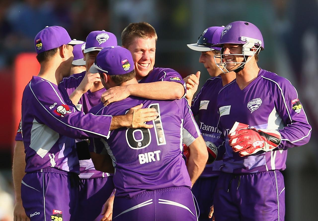 HOBART, AUSTRALIA - DECEMBER 23:  Xavier Doherty of the Hurricanes celebrates with team mates after taking a hat trick during the Big Bash League match between the Hobart Hurricanes and the Sydney Thunder at Blundstone Arena on December 23, 2012 in Hobart, Australia.  (Photo by Robert Cianflone/Getty Images)
