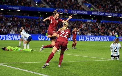 Jodie Taylor of England celebrates scoring the winning goal with Beth Mead during the 2019 FIFA Women's World Cup France group D match between England and Argentina - Credit: GETTY IMAGES